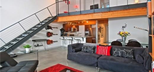 O vermelho é a cor de destaque nesse loft, que aproveitou cores mais sóbrias para delimitar diferentes espaços.