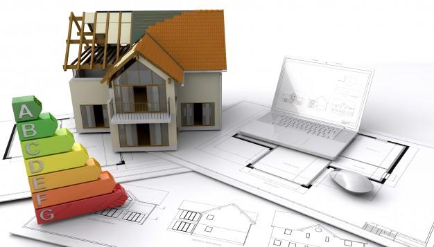 Maquete de uma casa sobre planos de ação e gráficos